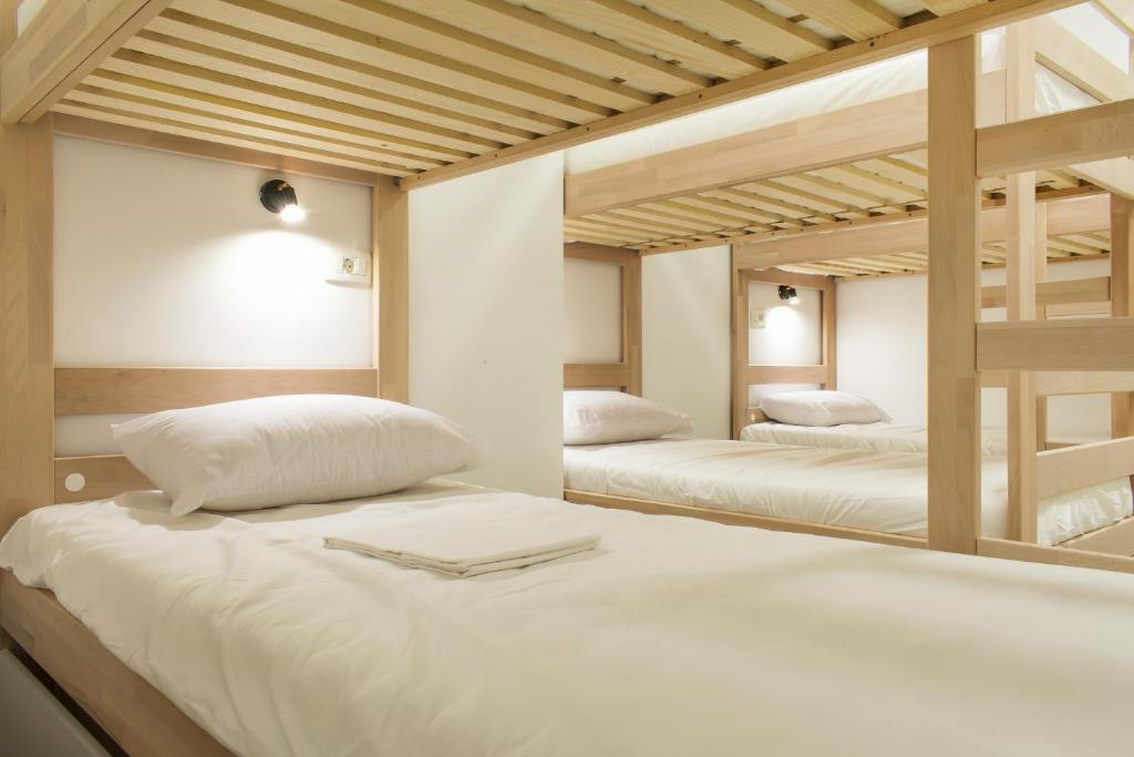 A bed or beds in a room at Gravitas Hostel