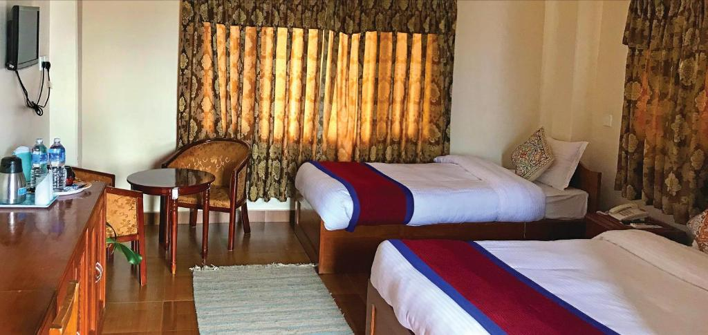 A bed or beds in a room at Hotel Asia