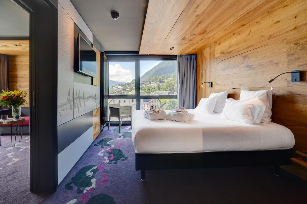 Letto o letti in una camera di Alpina Eclectic Hotel