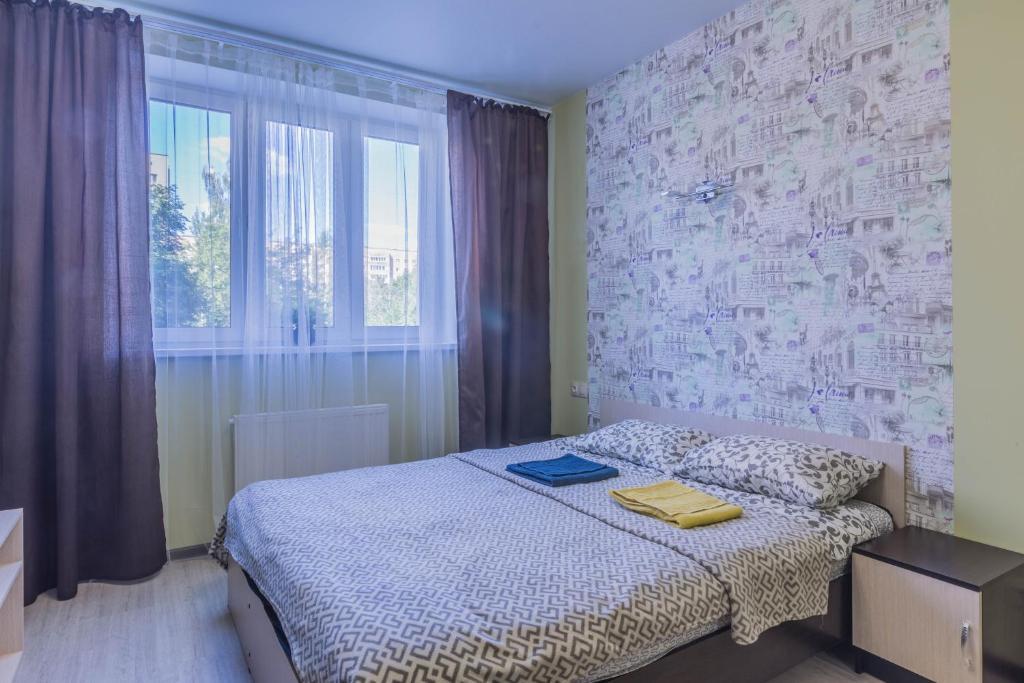 Кровать или кровати в номере Apartment on Nekrasova 13a