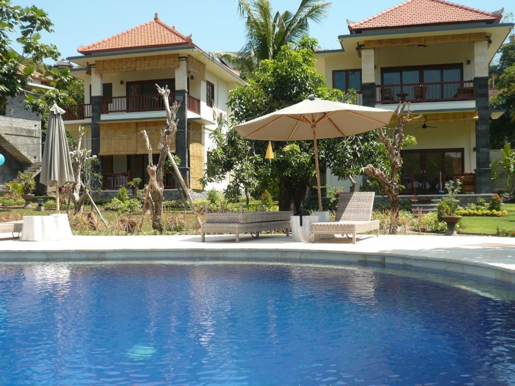 The swimming pool at or near Sukun Babonsay Villas