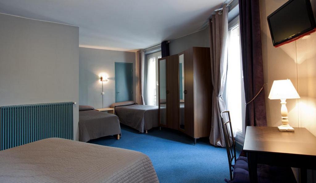 Ліжко або ліжка в номері Grand Hôtel De Paris