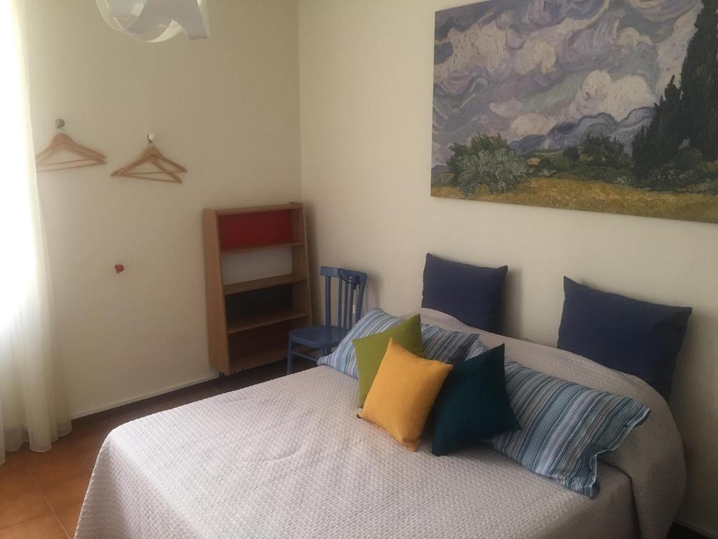 Uma cama ou camas num quarto em A casa di Elena