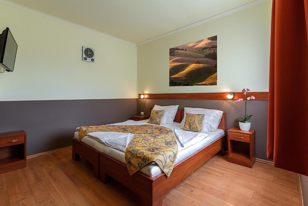 Un ou plusieurs lits dans un hébergement de l'établissement Aranypatkó Fogadó-Étterem