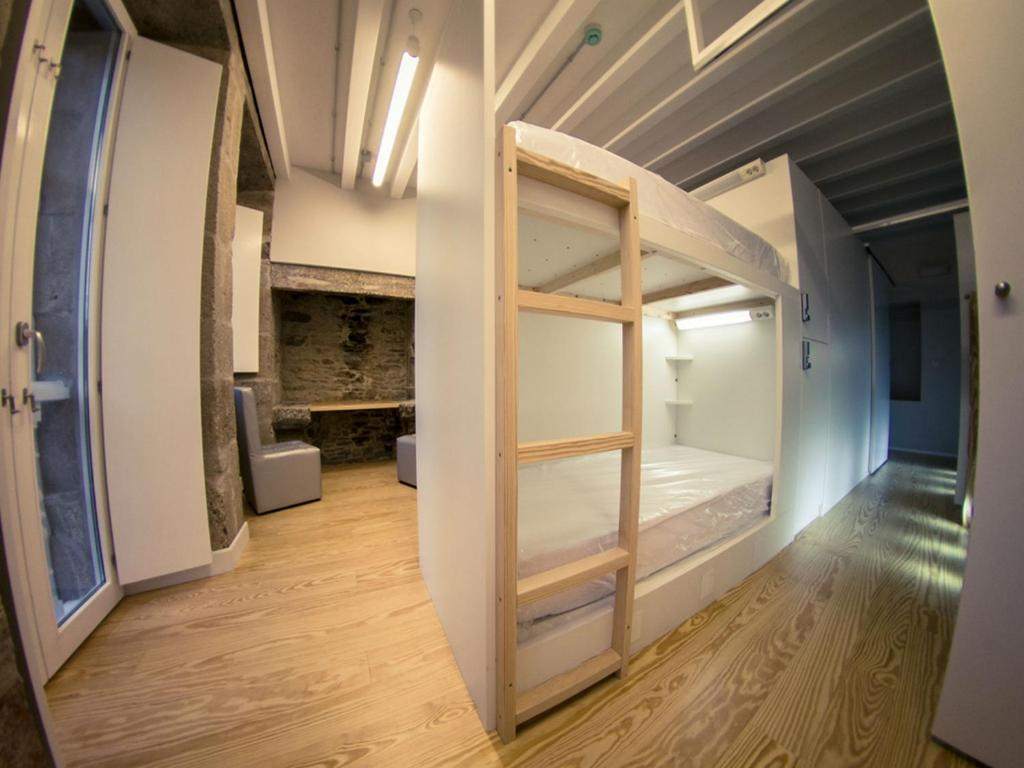 A bunk bed or bunk beds in a room at Albergue The Last Stamp