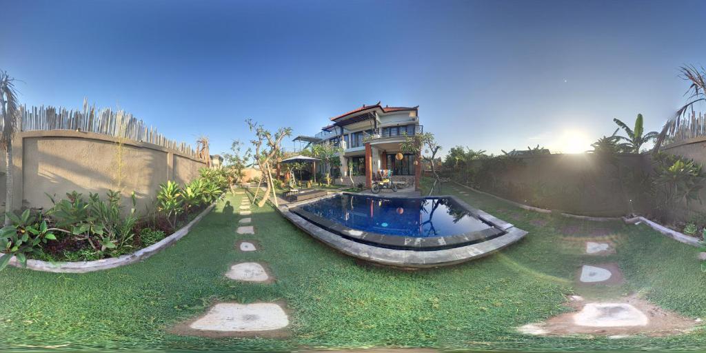 Kolam renang di atau di dekat Temuku Keramas Beach Suite