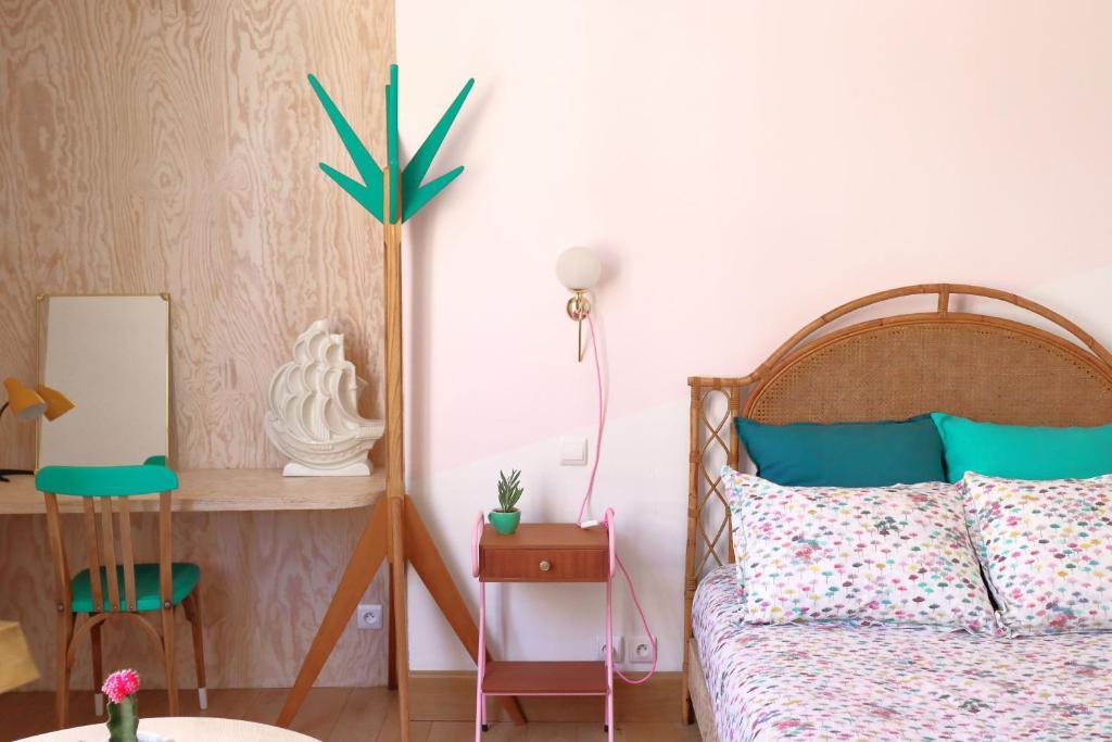 Postel nebo postele na pokoji v ubytování Le Petit Rivage Boutique hôtel