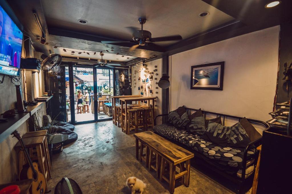 A seating area at DPM Bangkok Hostel Bar & Travel