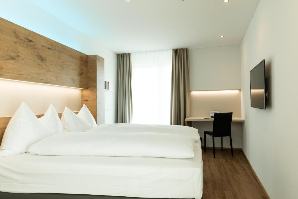 A bed or beds in a room at Jet Hotel Zurich Airport
