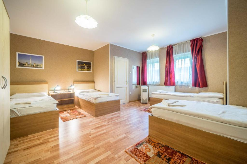 Letto o letti in una camera di Silver Hotel Budapest City Center