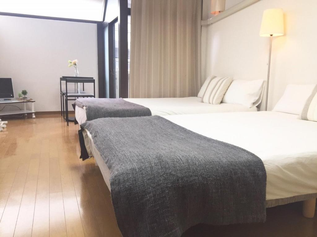 A bed or beds in a room at F Mansion / Vacation STAY 977