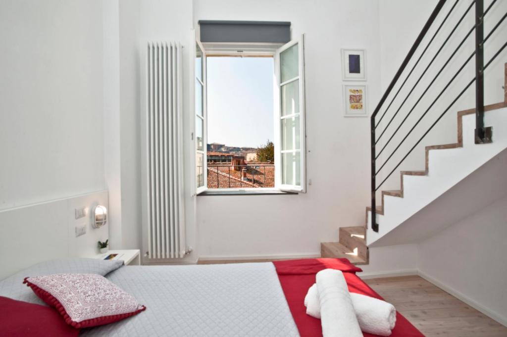 Un ou plusieurs lits dans un hébergement de l'établissement La Barriera di San Lorenzo - Dimora Storica