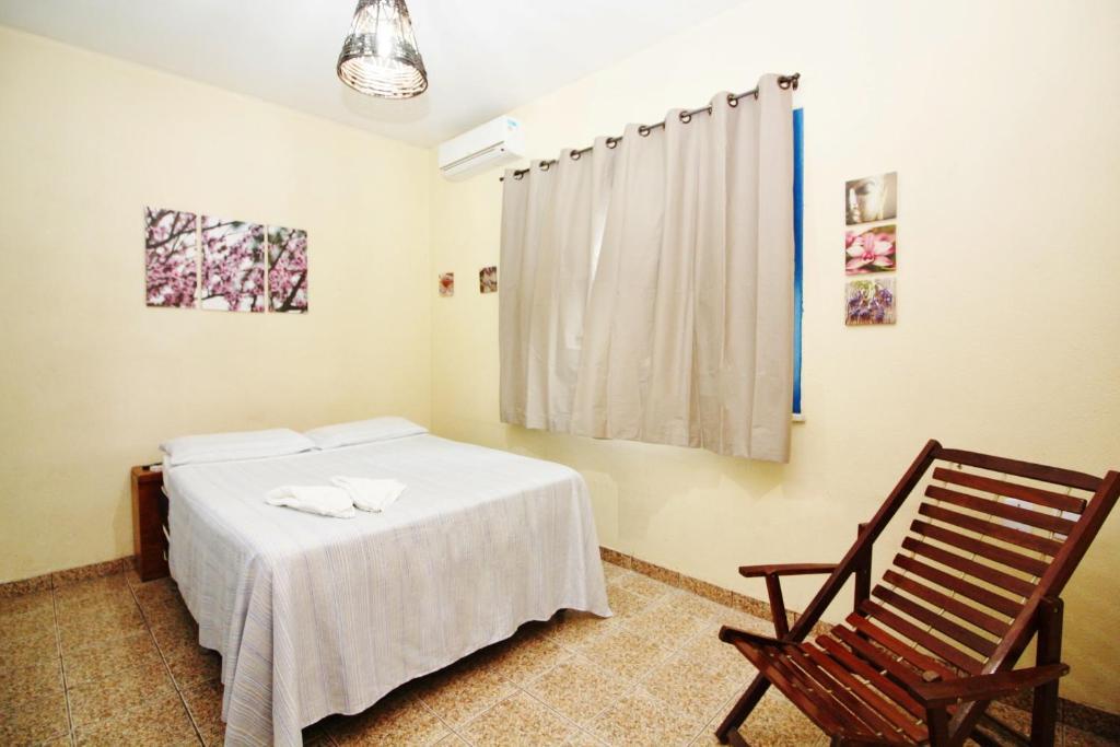 A bed or beds in a room at Pousada Fortaleza Aeroporto House