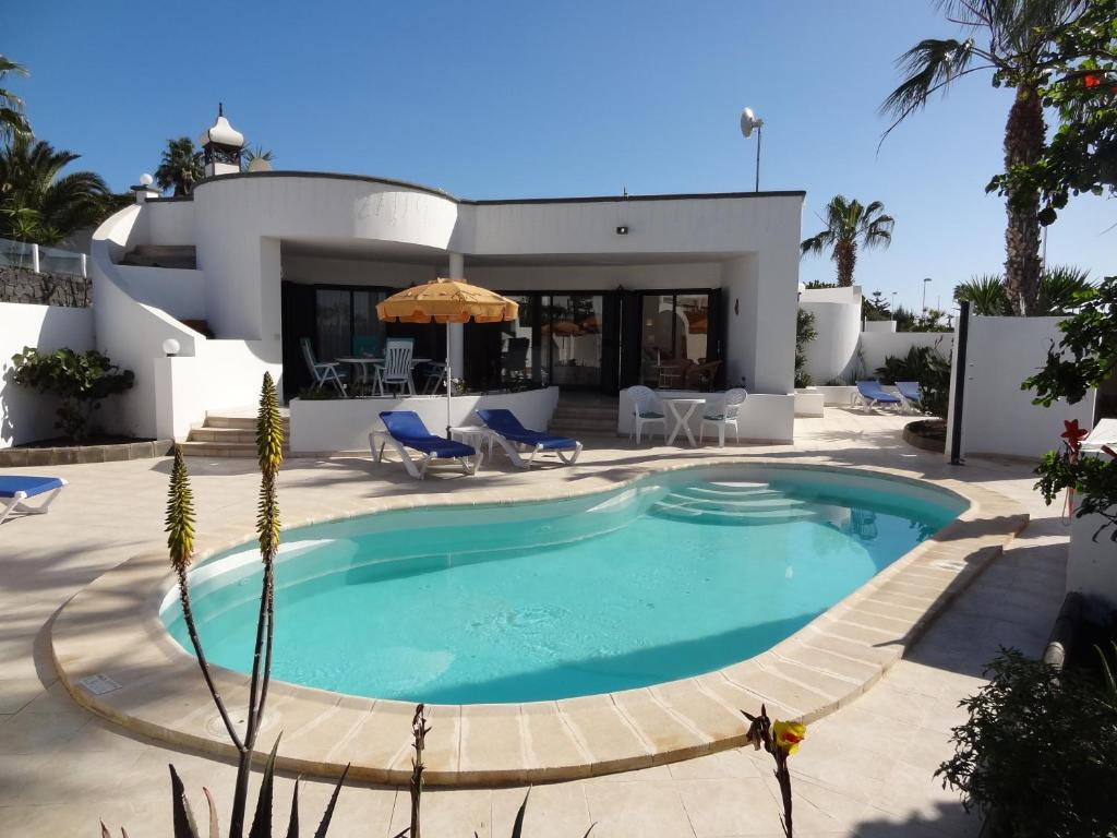 The swimming pool at or near Sol y Luna Room and Suite Lanzarote Holidays