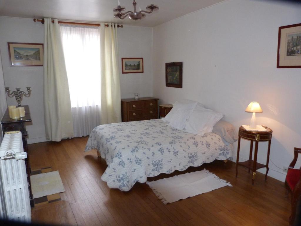 Un ou plusieurs lits dans un hébergement de l'établissement Dormir au 75