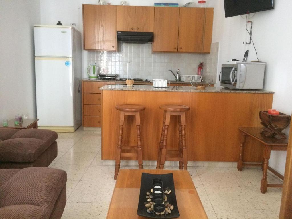O bucătărie sau chicinetă la Jacks Apartment