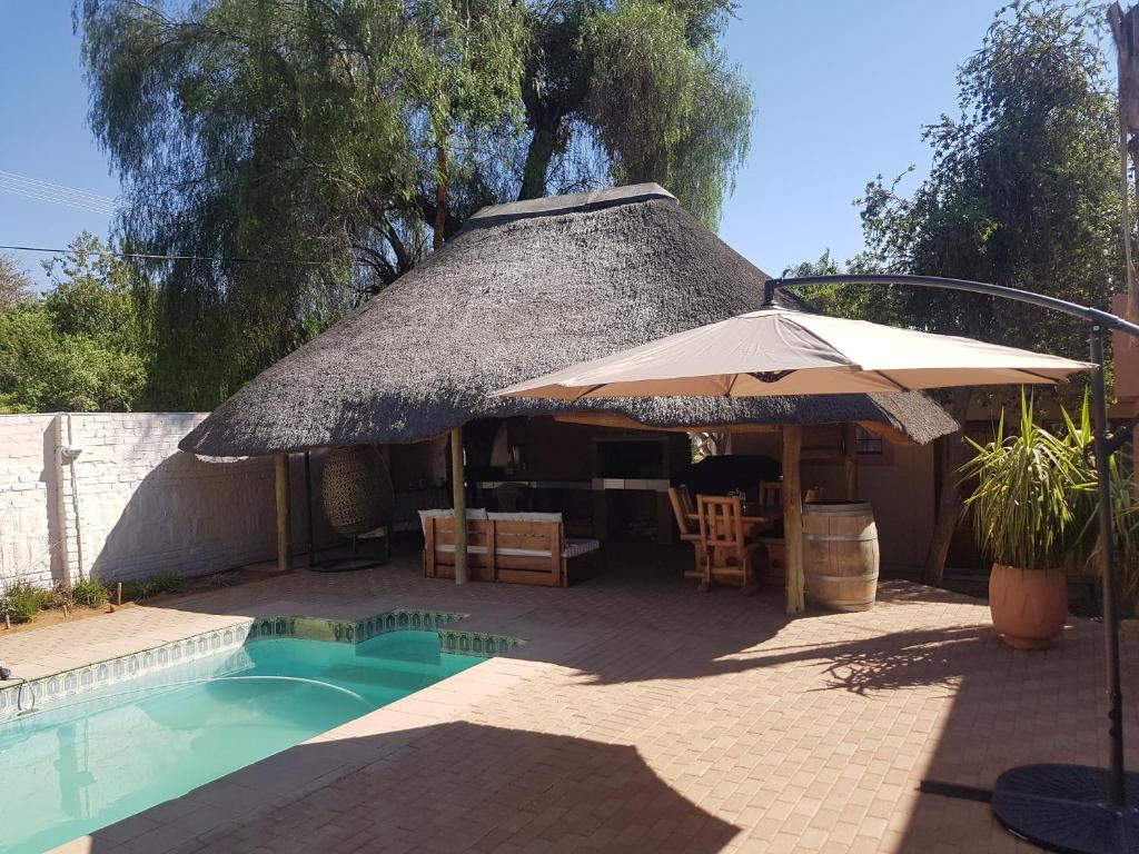 The swimming pool at or near New Beginnings Guesthouse