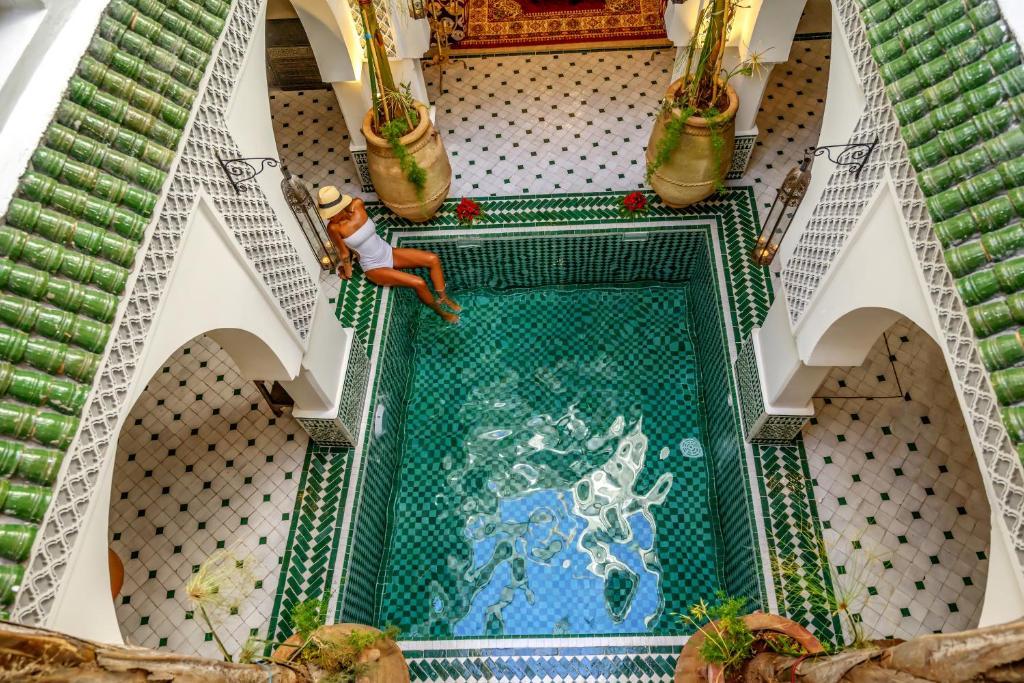The swimming pool at or near Riad Jemaa El Fna & Spa