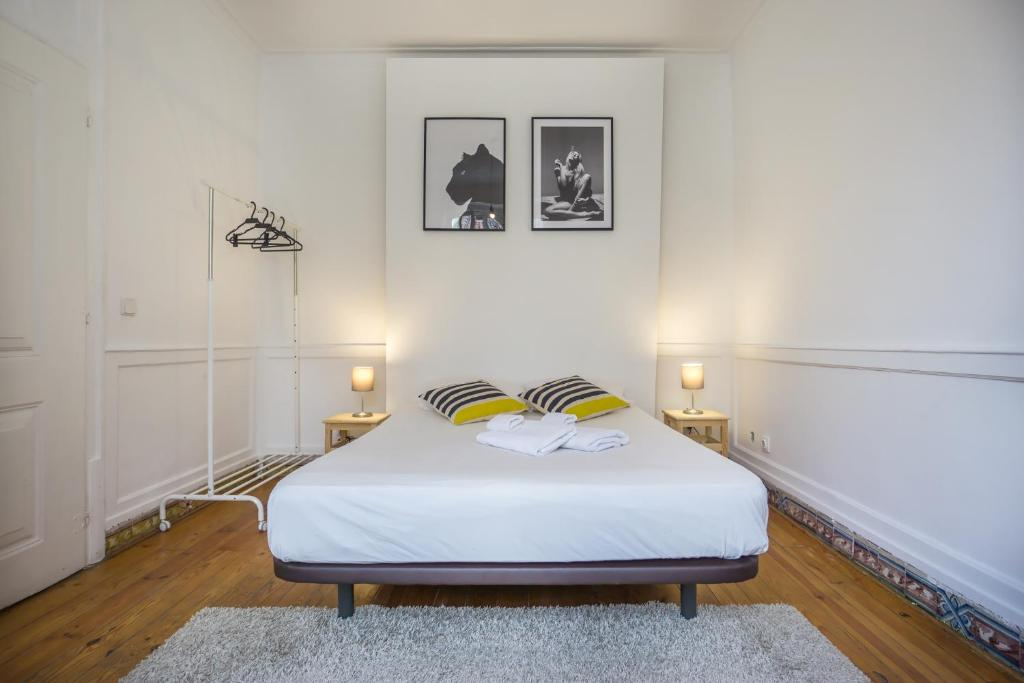 A bed or beds in a room at Original Lisbon Guesthouse