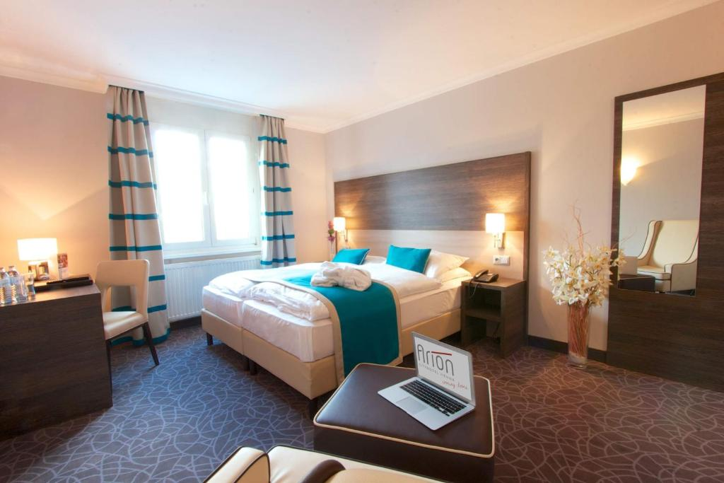 A bed or beds in a room at Arion Cityhotel Vienna und Appartements