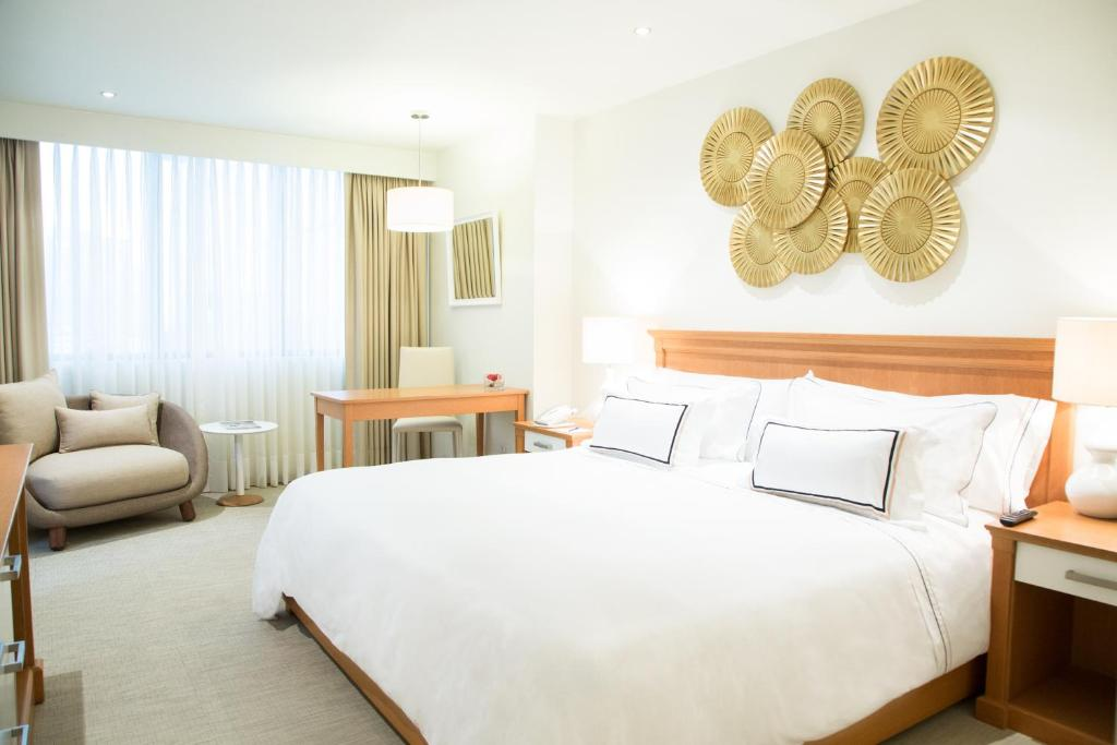 A bed or beds in a room at Hotel Melia Lima