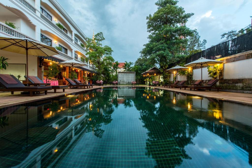 The swimming pool at or near Lin Ratanak Angkor Hotel