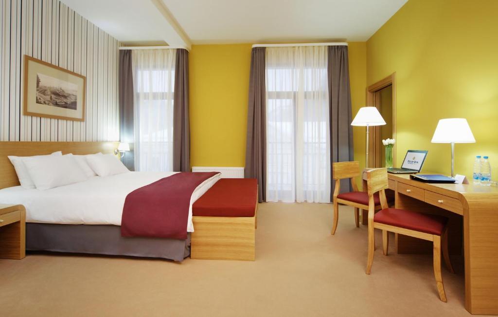 Кровать или кровати в номере Tulip Inn Rosa Khutor Hotel