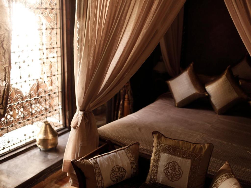 Postel nebo postele na pokoji v ubytování Riad ILayka