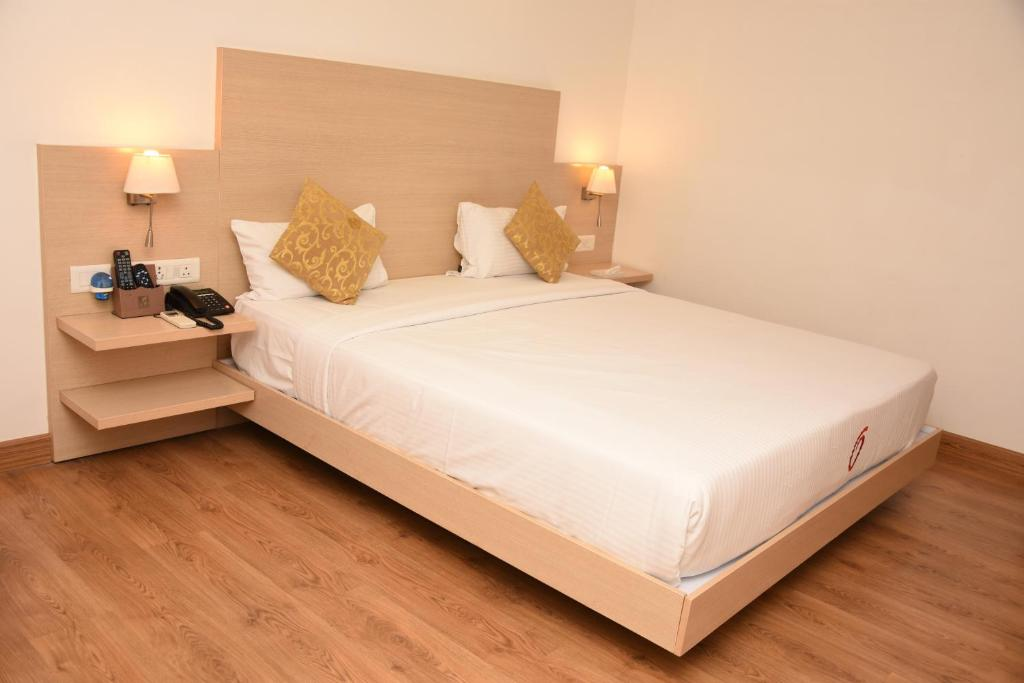 A bed or beds in a room at Grey Suit