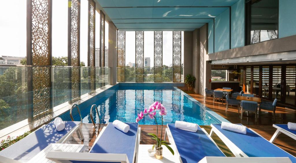The swimming pool at or close to Orchids Saigon Hotel