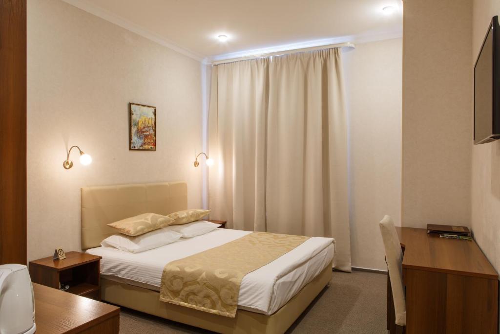 Кровать или кровати в номере Павелецкая Аэро