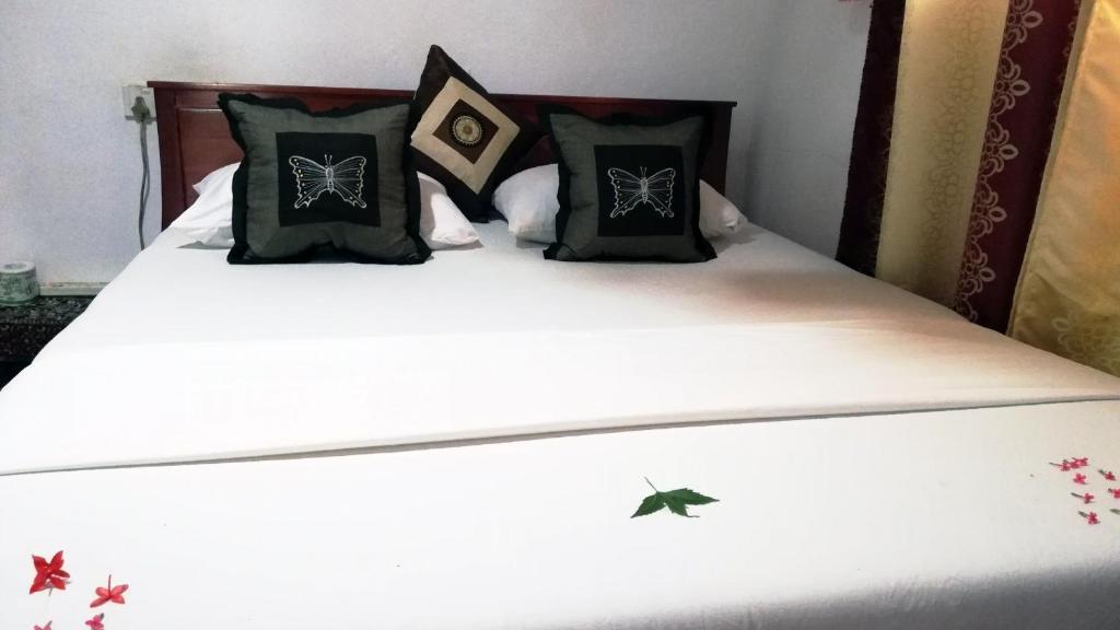 Cama o camas de una habitación en Anura Homestay