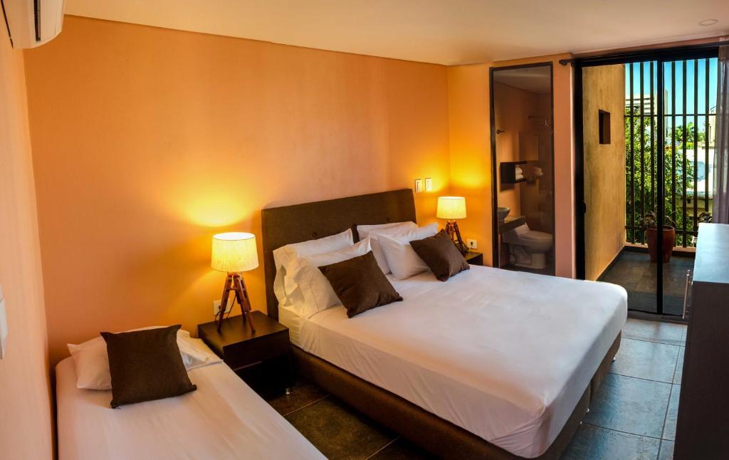 Cama o camas de una habitación en Oasis Fresh Hotel