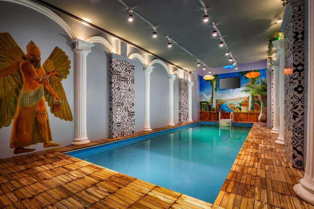 The swimming pool at or near Babylon Garden Hostel