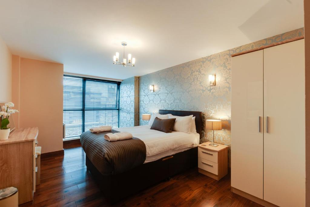 A bed or beds in a room at Base Serviced Apartments - Duke Street