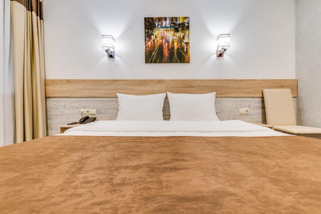 Кровать или кровати в номере Hotel Welcome inn