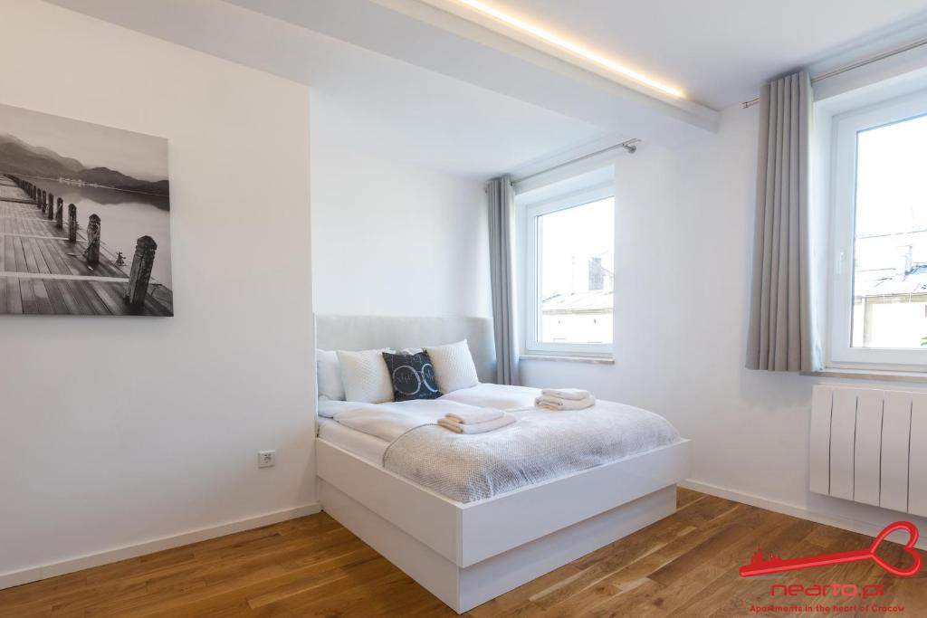 A bed or beds in a room at Apartment Nearto Old Town Sebastiana street