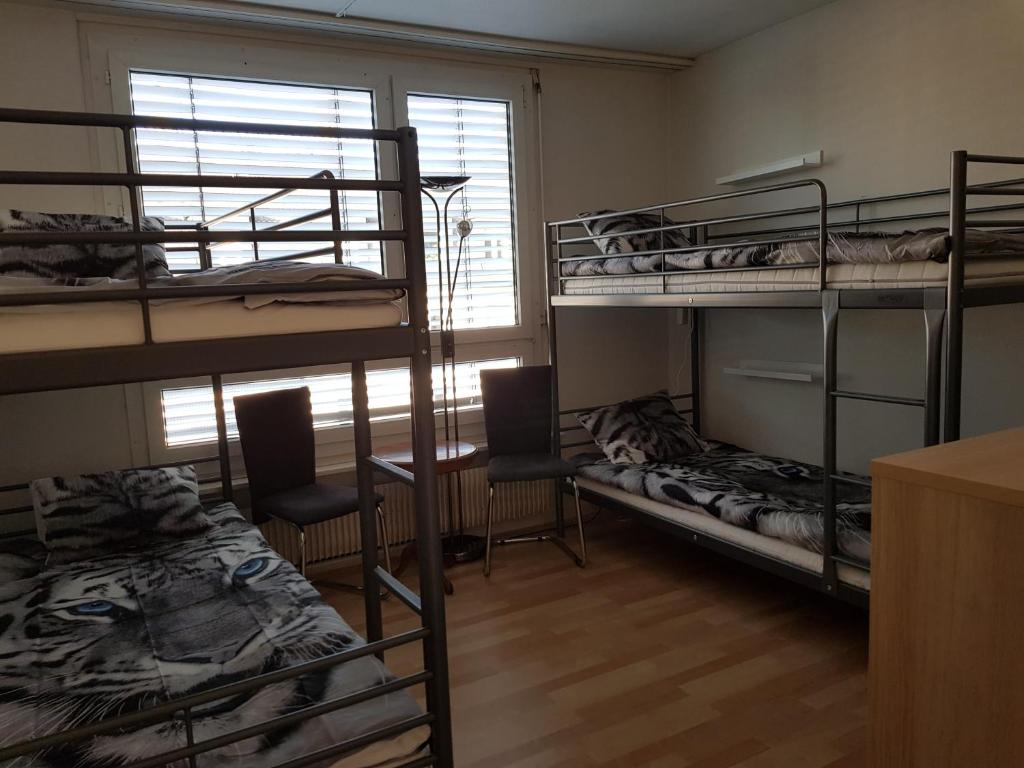 A bunk bed or bunk beds in a room at SOS Budget Hotel