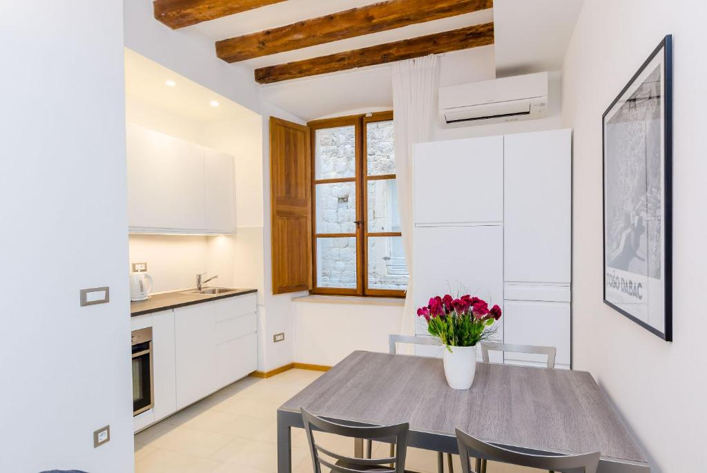 A kitchen or kitchenette at Zelenci Apartments