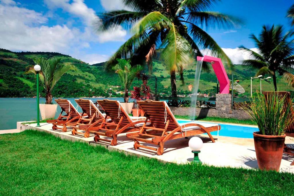 The swimming pool at or near Pousada Sol da Manha