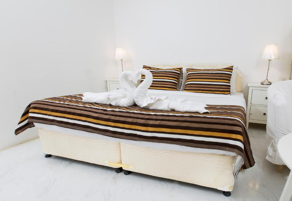 A bed or beds in a room at Byruha Ibra