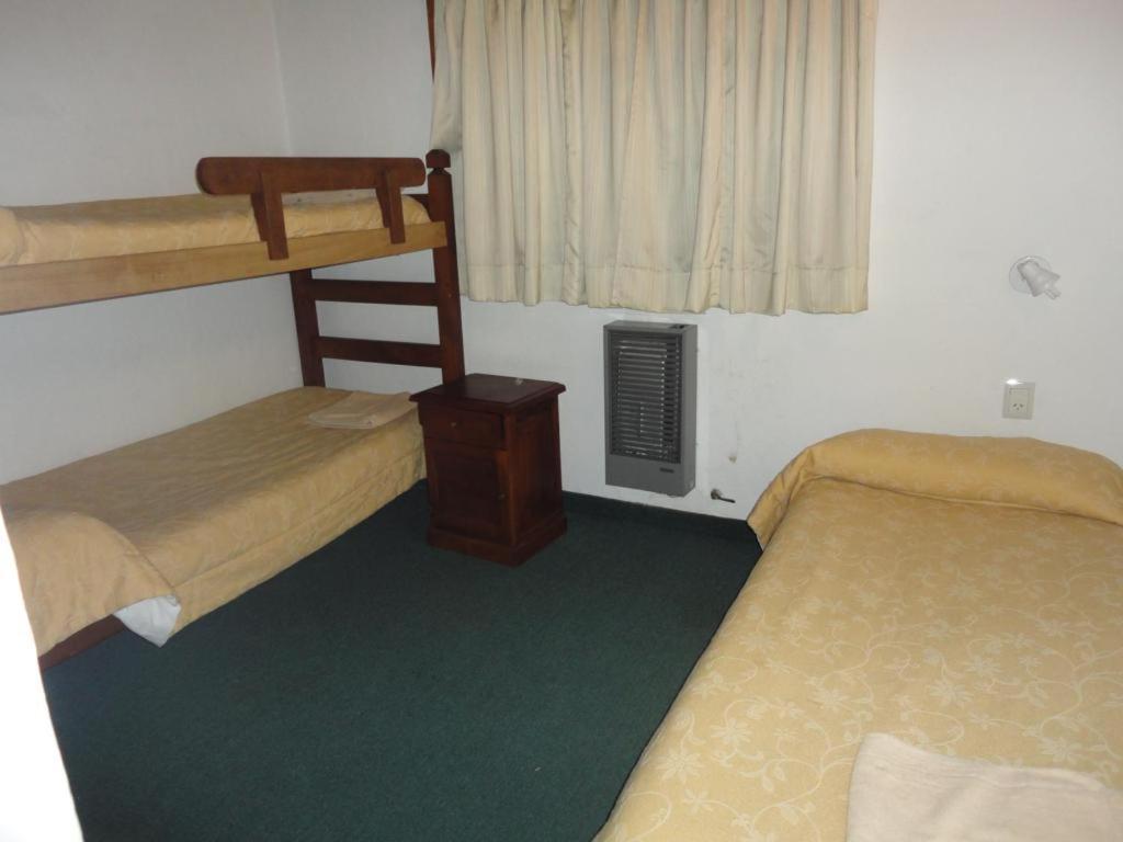 Una cama o camas cuchetas en una habitación  de 7 Lagos