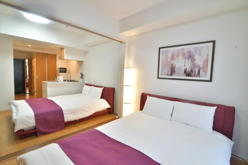 A bed or beds in a room at European House Reisen
