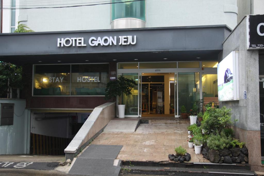 The facade or entrance of Hotel Gaon J Stay