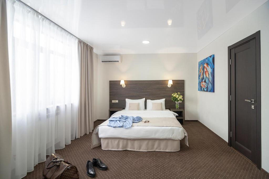 Кровать или кровати в номере Отель Галера