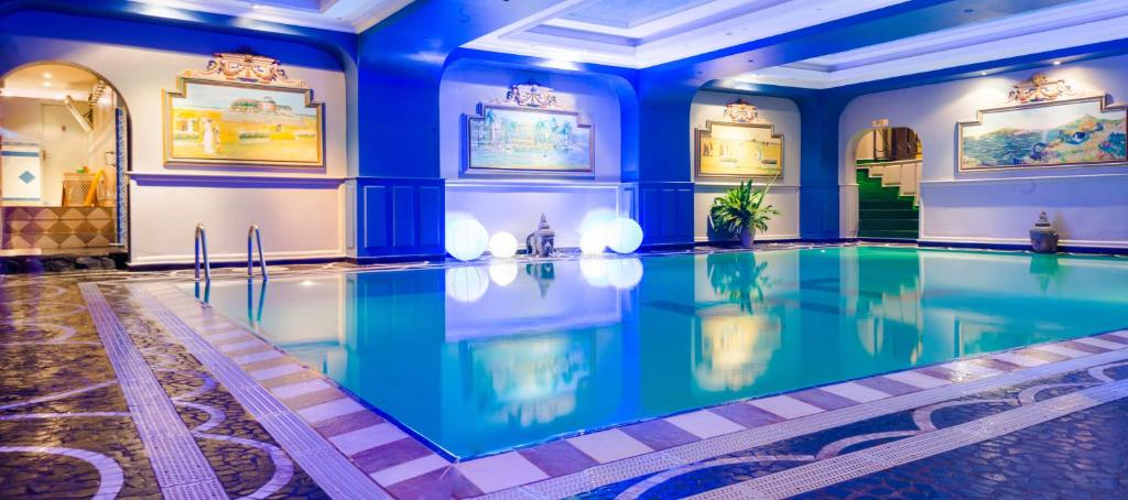 The swimming pool at or near Hôtel Colbert - Spa & Casino