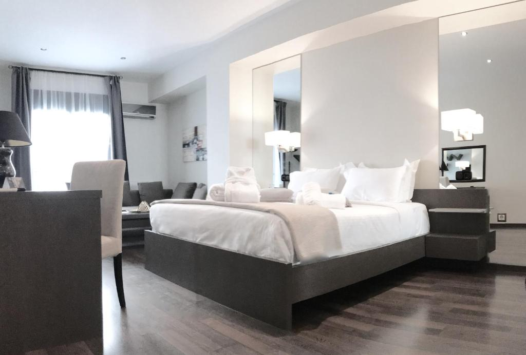 A bed or beds in a room at Athens Luxury Suites