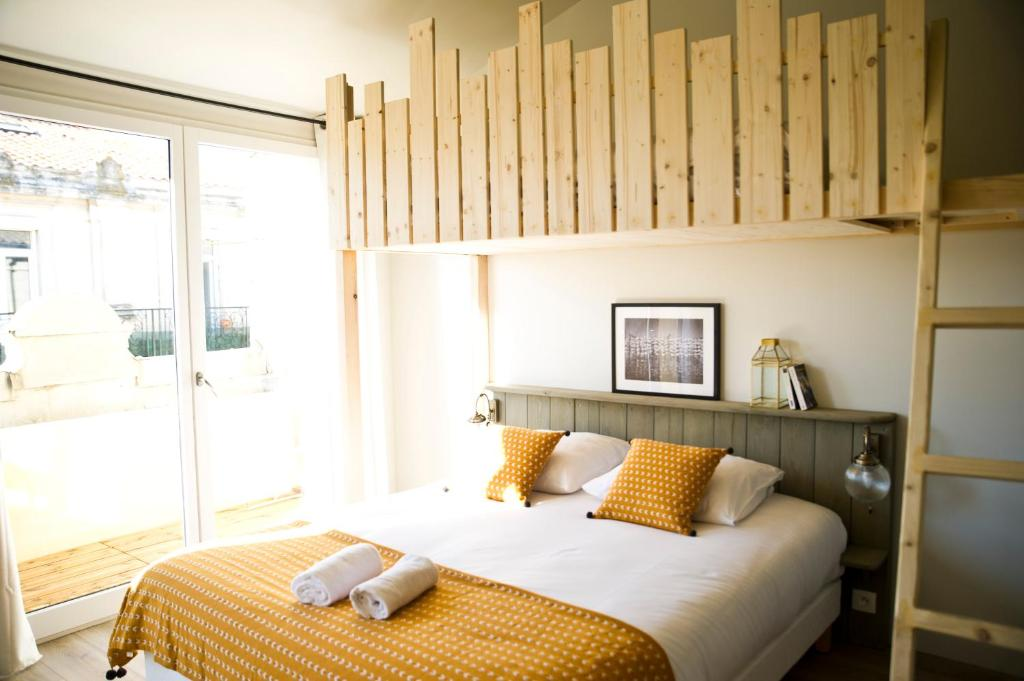 A bed or beds in a room at Georges Hostel & Café