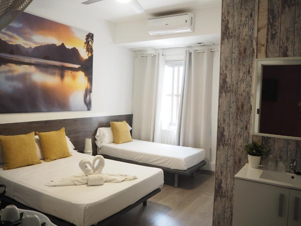 A bed or beds in a room at Valencia Suits You Citytel - Adults Only