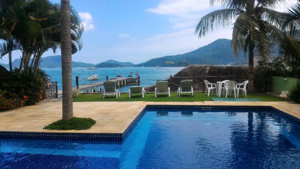 The swimming pool at or near Apartamento em Condominio Fechado - Angra dos Reis - Piscina, Praia, Lazer